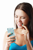 Smiling woman cellphone Royalty Free Stock Image