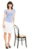 Smiling woman with a chair Royalty Free Stock Photography