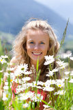 Smiling woman and chamomiles. Smiling woman in field of chamomiles Stock Photography