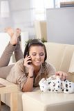 Smiling woman chatting on mobile Royalty Free Stock Image