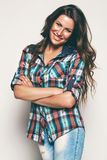 Smiling woman in check shirt. In studio Stock Photography