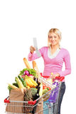 A smiling woman checking her shopping receipt Stock Photography