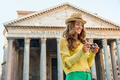 Smiling woman checking photos at the Pantheon in Rome in summer Royalty Free Stock Images
