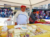 Smiling woman cheese sells at opened market stock image