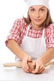 Smiling woman chef holding dough in the hands Stock Images