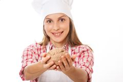 Smiling woman chef holding dough in the hands Stock Photo
