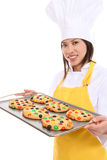 Smiling Woman Chef with Tray of Cookies Stock Photos