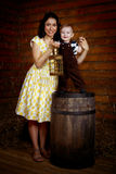 Smiling woman with a child standing next Royalty Free Stock Photography