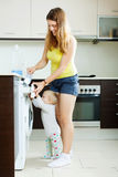Smiling  woman and child using washing machine Royalty Free Stock Photography
