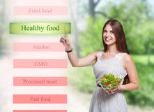 Smiling woman choose healthy food on futuristic screen Royalty Free Stock Photography
