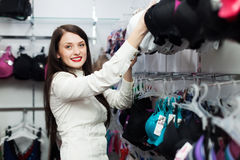 Smiling woman choosing underwear Stock Images