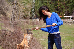 Smiling woman chopping and splitting wood Stock Photos