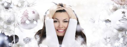 Smiling woman on Christmas background with balls Royalty Free Stock Photography