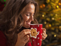 Smiling woman with christmas cookie and cup of chocolate Royalty Free Stock Photography