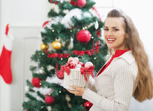 Smiling woman with christmas decorations near christmas tree Royalty Free Stock Images