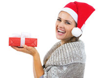 Smiling woman in christmas hat holding christmas present box Royalty Free Stock Image