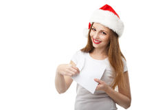 Smiling woman in christmas hat holding mail Stock Photos