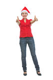 Smiling woman in Christmas hat showing thumbs up Royalty Free Stock Photography