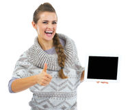 Smiling woman in christmas hat with tablet pc blank screen Royalty Free Stock Images