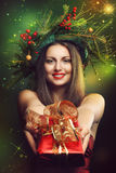 Smiling woman and christmas magic Royalty Free Stock Photos