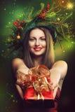 Smiling woman and christmas magic Royalty Free Stock Photos