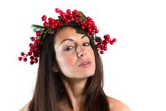 Smiling woman with a Christmas wreath on her head stock photography