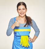 Smiling woman cleaner worker shows thumb up. Stock Photo