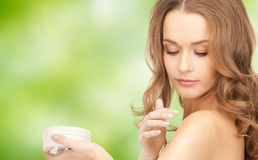 Smiling woman cleaning face skin with cotton pad Stock Images