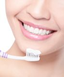 Smiling woman cleaning teeth with toothbrush Stock Photos
