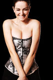 Smiling woman with cleavage in a corset Royalty Free Stock Photos