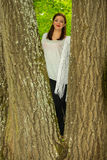 Smiling woman climber in the tree Royalty Free Stock Photos