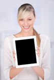 Smiling woman. Close up portrait of smiling woman shows digital tablet against the white background stock photo
