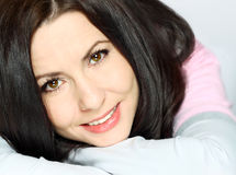 Smiling woman. Close up of young female head shot with smile and brown hair Royalty Free Stock Images