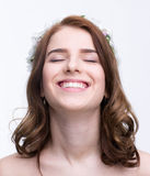 Smiling woman with closed eyes Stock Images