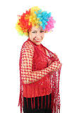 Smiling woman in clown wig and red shawl. Portrait of young smiling woman in clown wig and red shawl, half body, isolated on white Stock Photos