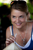 Smiling Woman with a Coconut Drink in Bali Stock Images