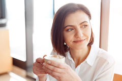 Smiling woman with coffee Stock Photos