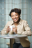 Smiling Woman with Coffee Cup Royalty Free Stock Photos