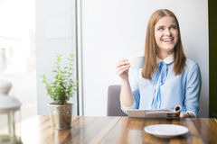 Smiling woman in coffee shop Royalty Free Stock Photos