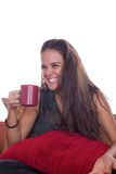 Smiling woman with coffee  on sofa Stock Image