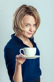 Smiling woman with coffee or tea cup Royalty Free Stock Photography