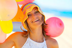 Smiling woman with colorful balloons outdoor Royalty Free Stock Image