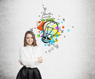 Smiling woman and colorful light bulb Royalty Free Stock Image