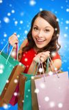 Smiling woman with colorful shopping bags Stock Images
