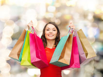 Smiling woman with colorful shopping bags Royalty Free Stock Photos
