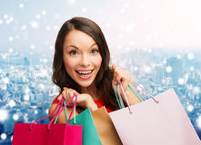 Smiling woman with colorful shopping bags Stock Photo