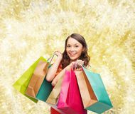 Smiling woman with colorful shopping bags Royalty Free Stock Image