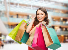 Smiling woman with colorful shopping bags Royalty Free Stock Photo