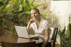 Smiling Woman at Computer Stock Images