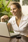 Smiling Woman at Computer Royalty Free Stock Photos
